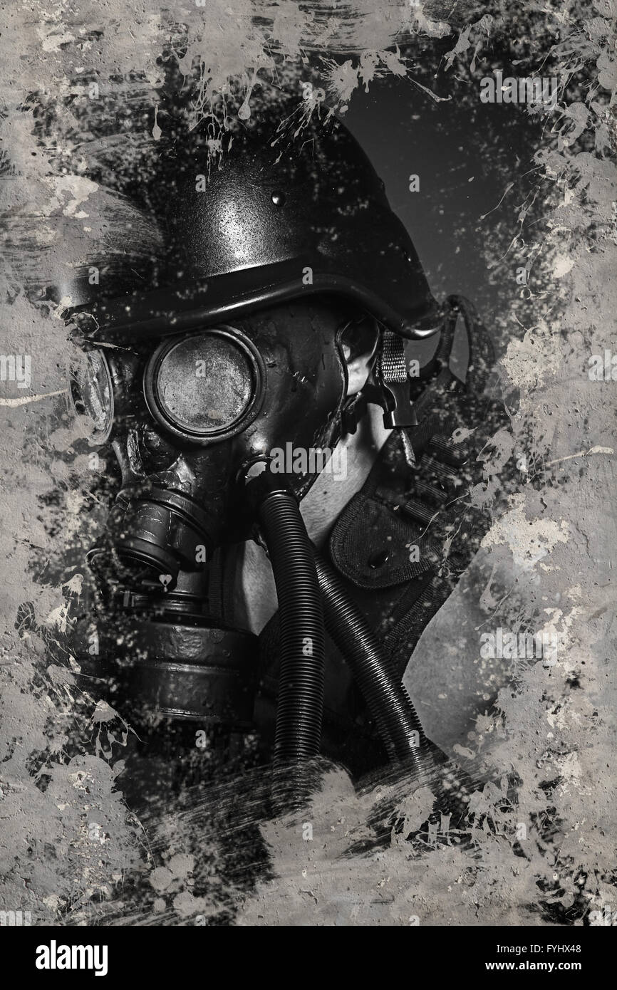 Danger Pollution, Man with gas black mask - Stock Image