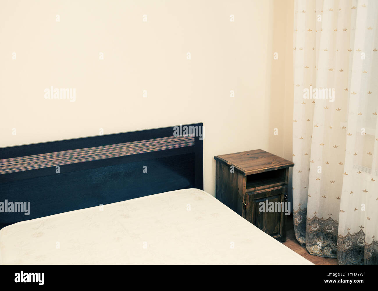 Part of a room with bed in a corner colorized view - Stock Image