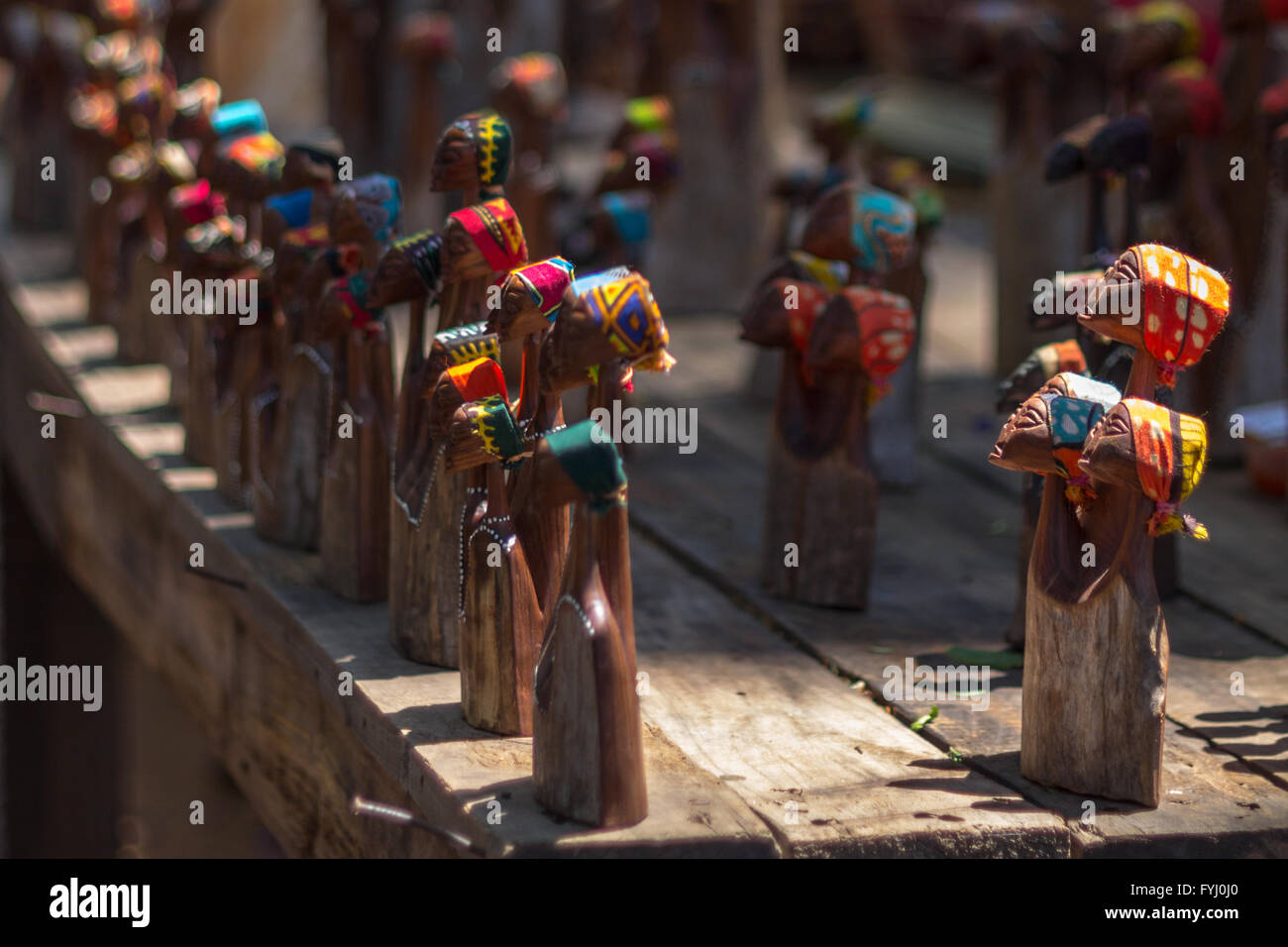 Wooden figurines at craft market in Swaziland. - Stock Image