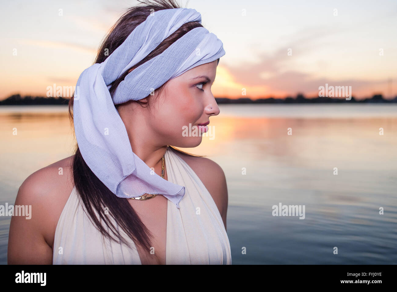 Beautiful young woman summertime portrait retro lifestyle.  Profile view - Stock Image