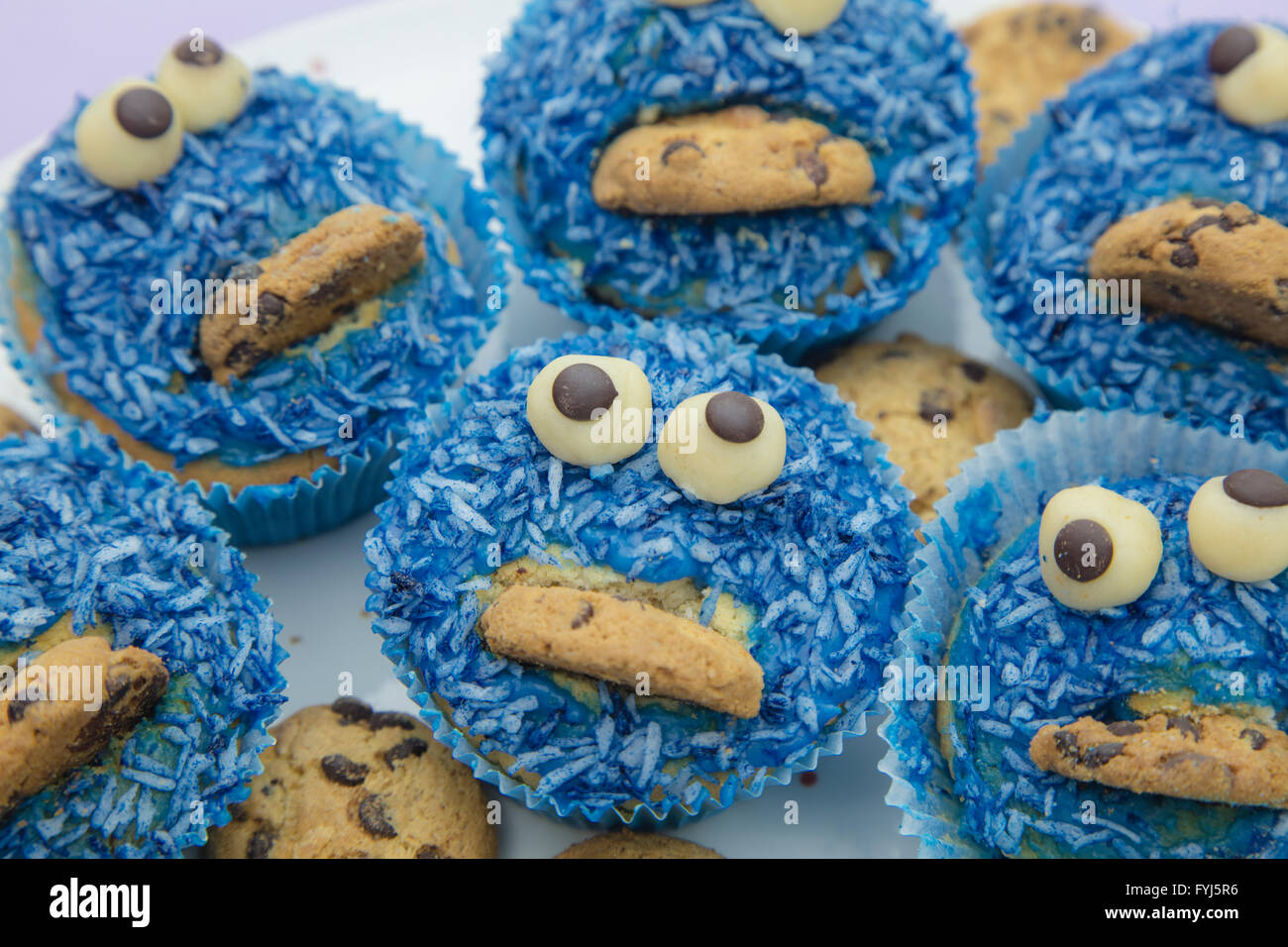 Handmade coconut muffins with chocolate cookies - Stock Image