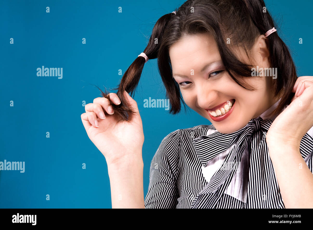 Grinning with my ponytails - Stock Image