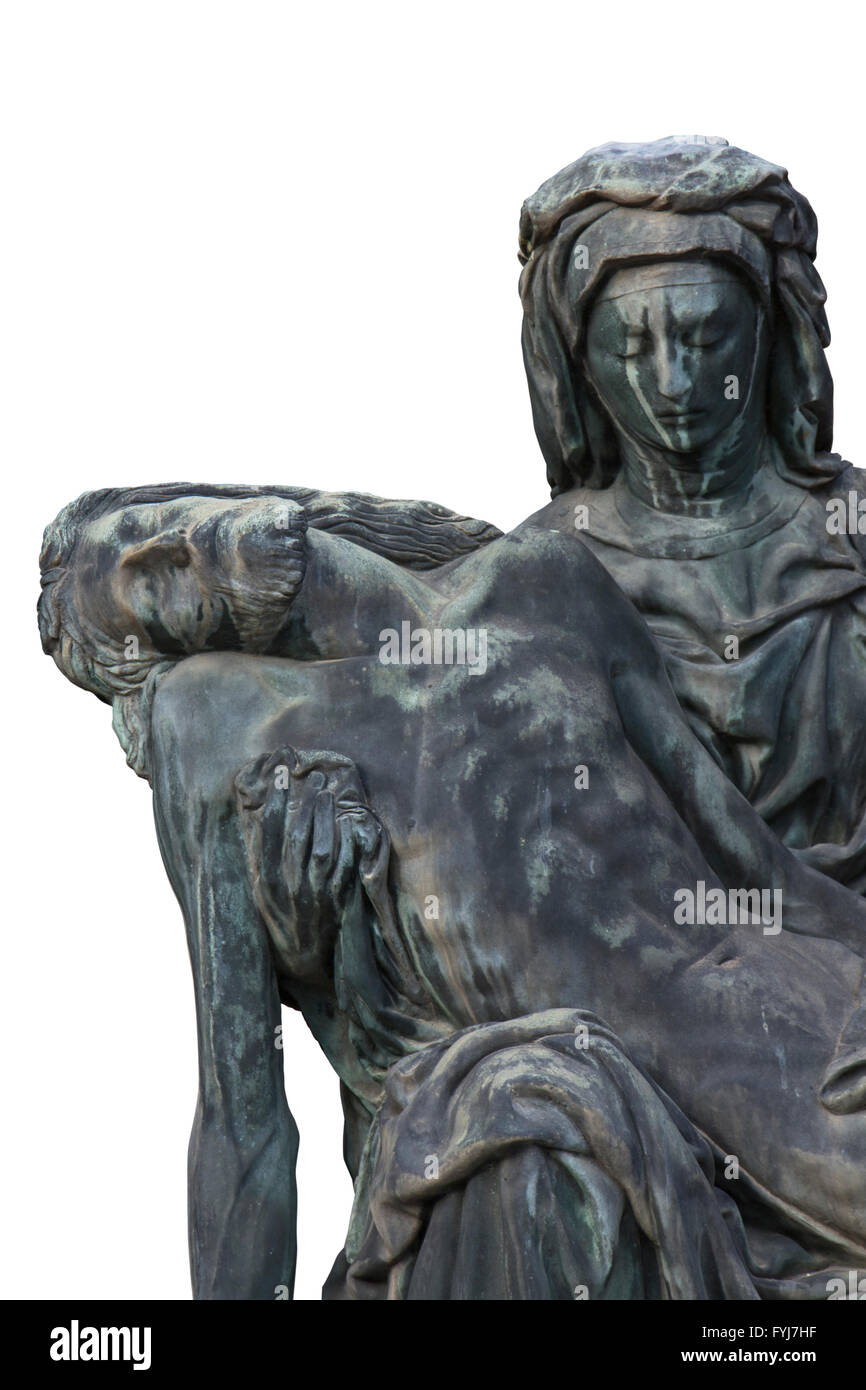 Bronze statue of Virgin Mary holding the body of Jesus Christ with isolated white background. It´s called 'Piety' - Stock Image