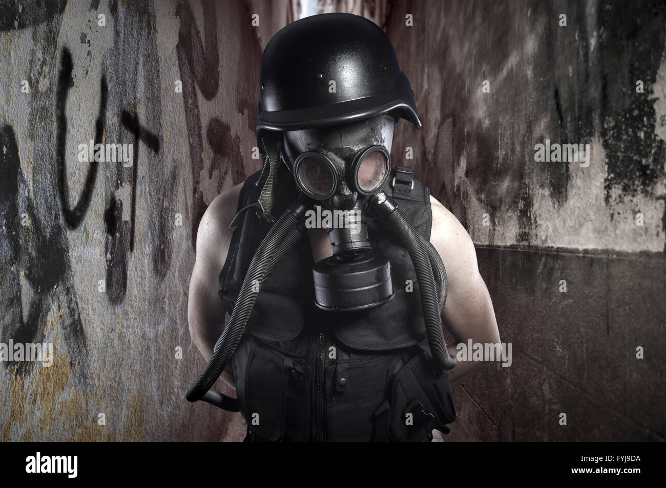 Survival.Environmental disaster. Post apocalyptic survivor in gas mask - Stock Image