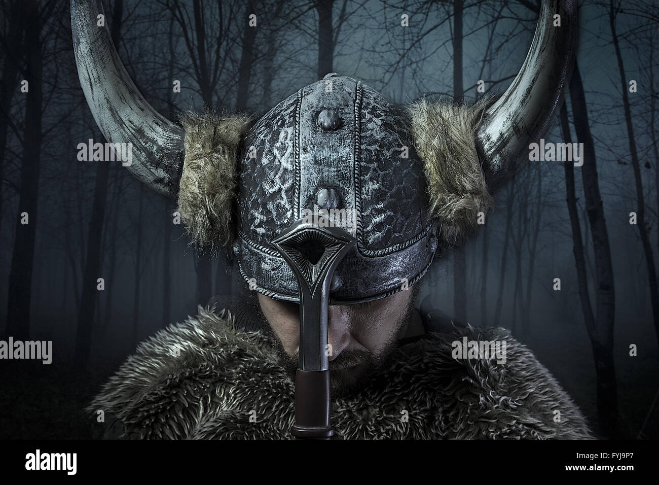 Peace, Viking warrior, male dressed in Barbarian style with sword, bearded Stock Photo