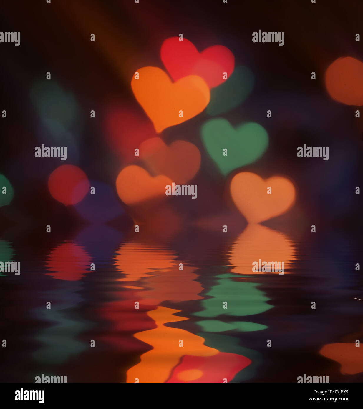 Blurred bokeh colorful lights with reflection in water - Stock Image
