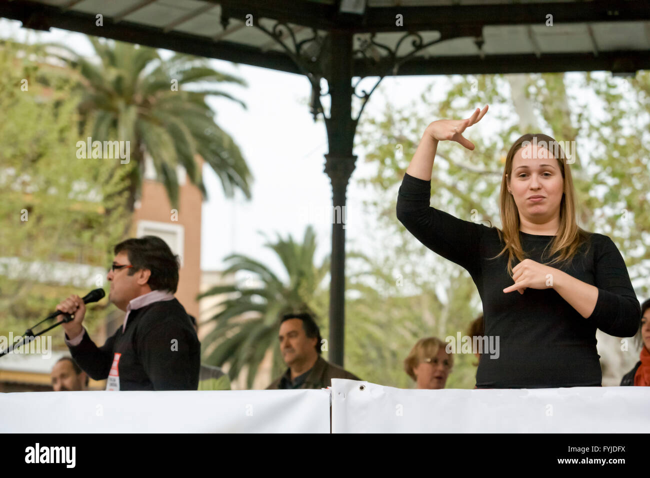 Badajoz, Spain - March 29, 2012: sign language woman interpreter gestures during a meeting that protests against - Stock Image