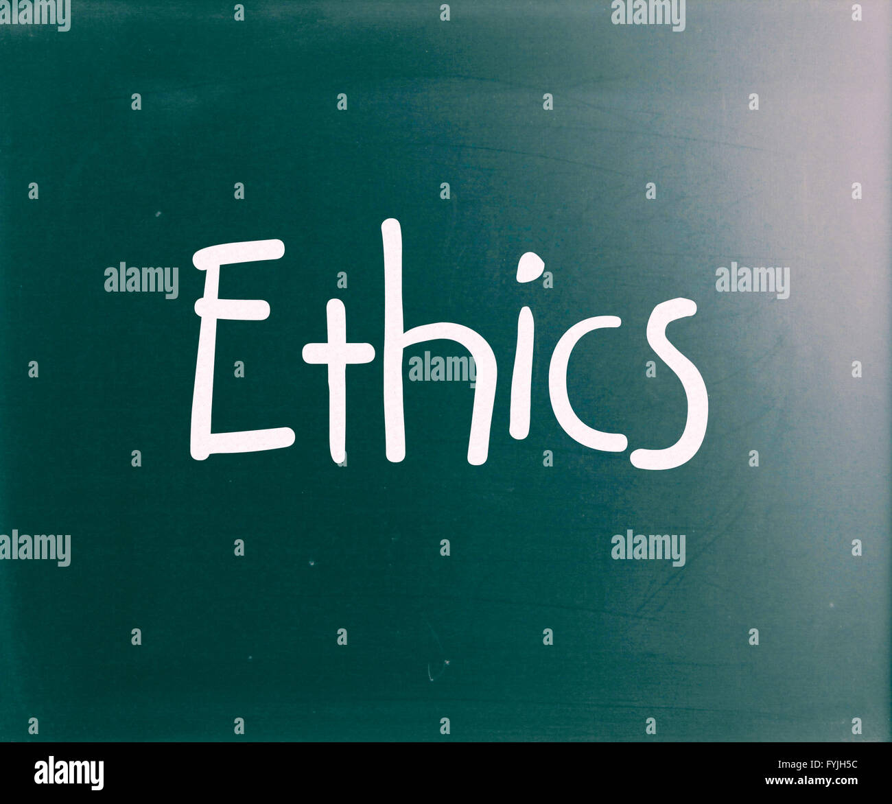 The word Ethics handwritten with white chalk on a blackboard - Stock Image