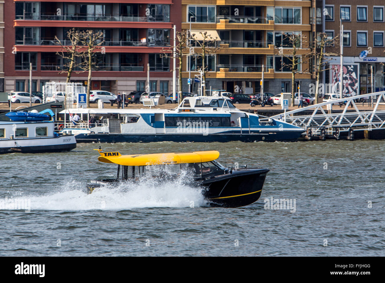 water taxi boat on river  Nieuwe Maas, Rotterdam, The Netherlands, Stock Photo