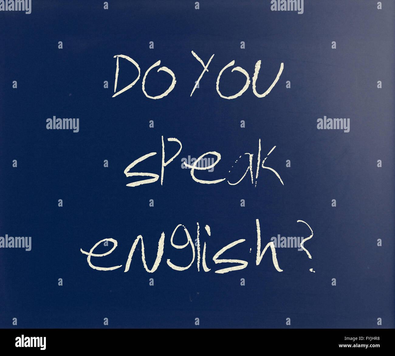 Do you speak english handwritten with white chalk on a blackboard - Stock Image