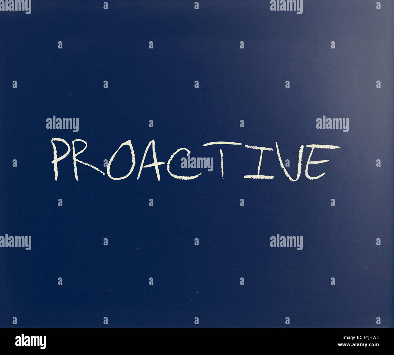 'Proactive' handwritten with white chalk on a blackboard - Stock Image