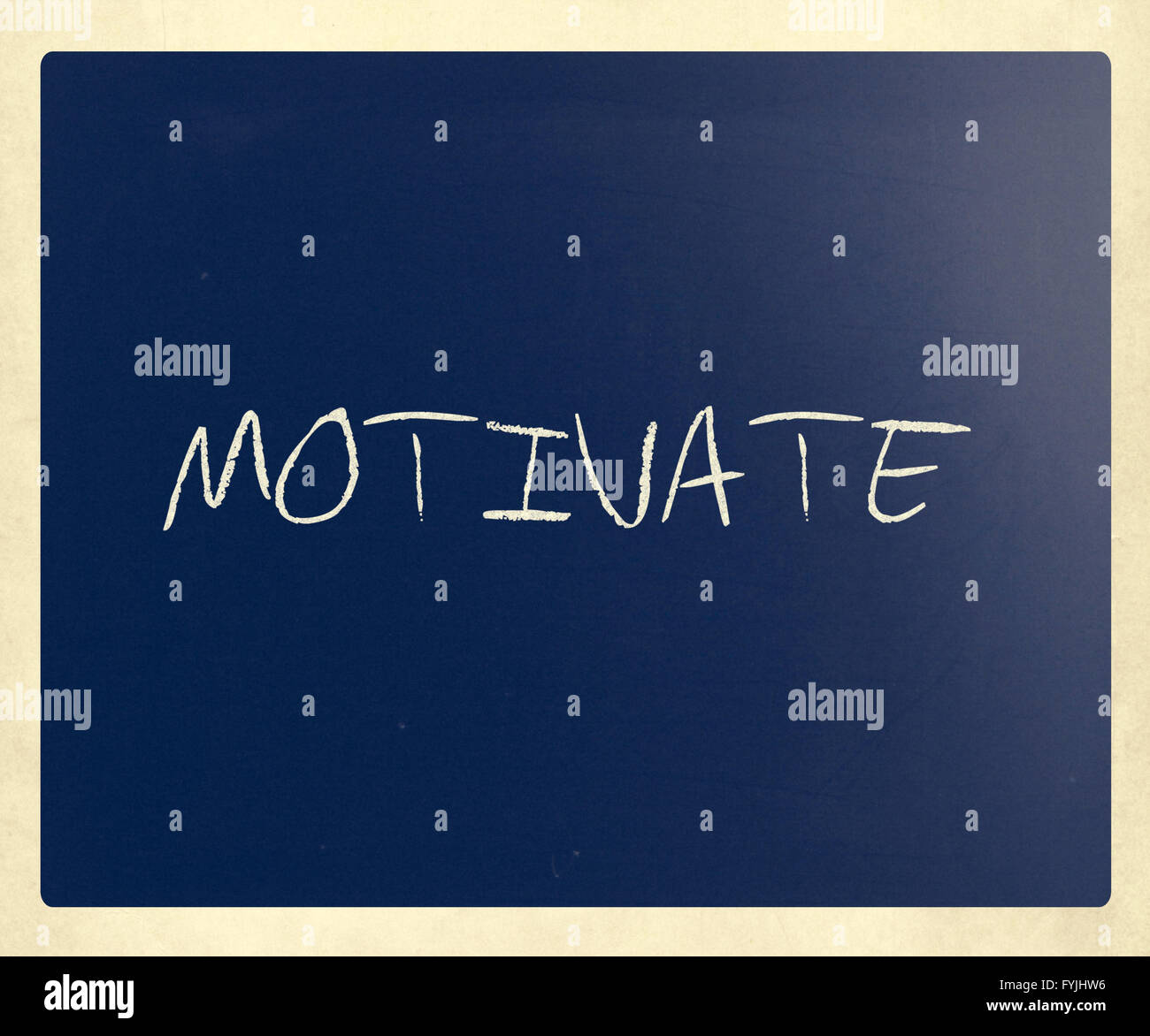 Motivate handwritten with white chalk on a blackboard - Stock Image