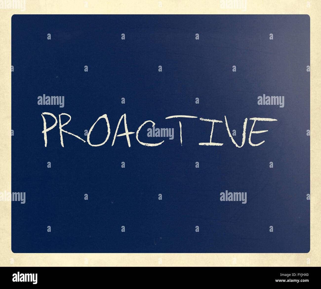 The word 'Proactive' handwritten with white chalk on a blackboard - Stock Image