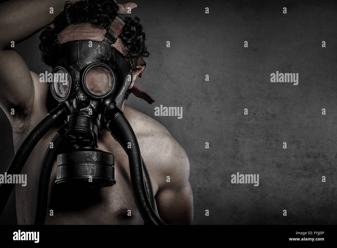Pollution, nuclear disaster, man with gas mask, protection - Stock Image