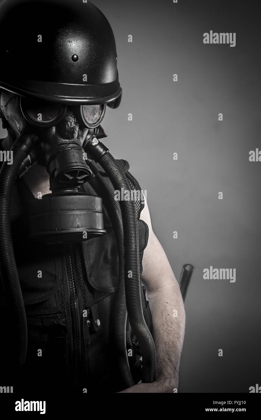 Smoke, nuclear disaster, man with gas mask, protection - Stock Image