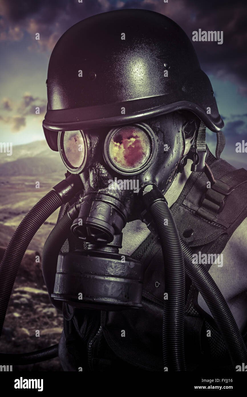 Apocalypse, nuclear disaster, man with gas mask, protection - Stock Image
