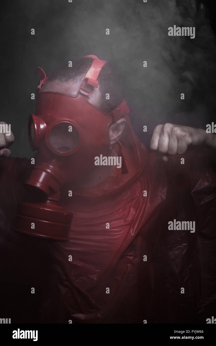 Ebola infection concept, man with red gas mask - Stock Image