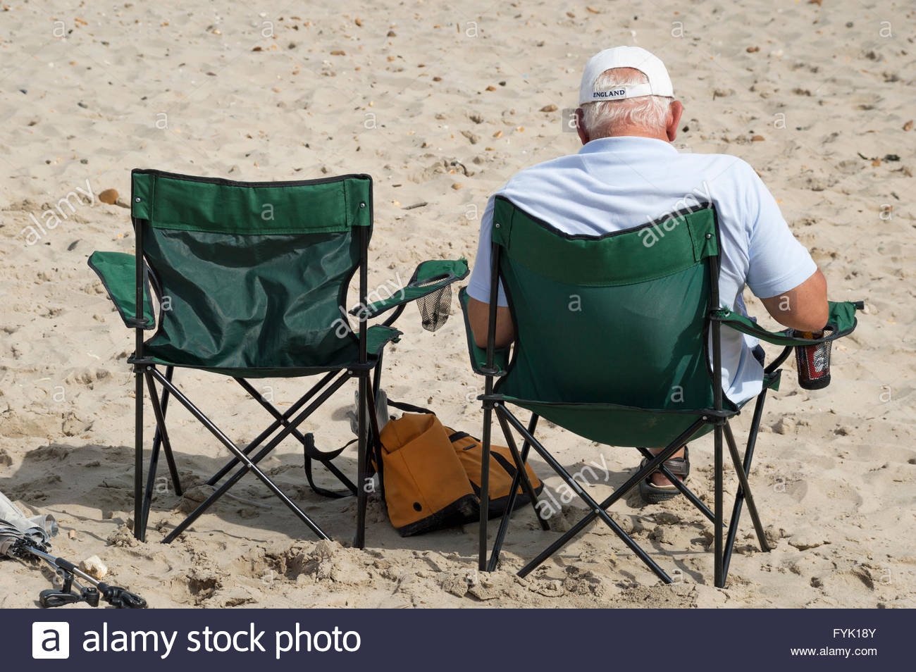 Astounding Older Man Sitting On The Beach In A Camping Chair Mudeford Cjindustries Chair Design For Home Cjindustriesco