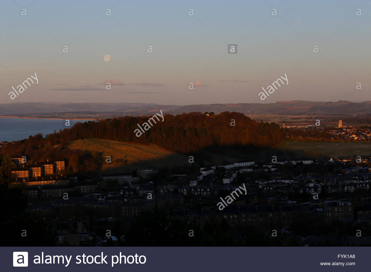 Full moon over Balgay Hill and western Dundee at dawn Scotland  April 2016 - Stock Image