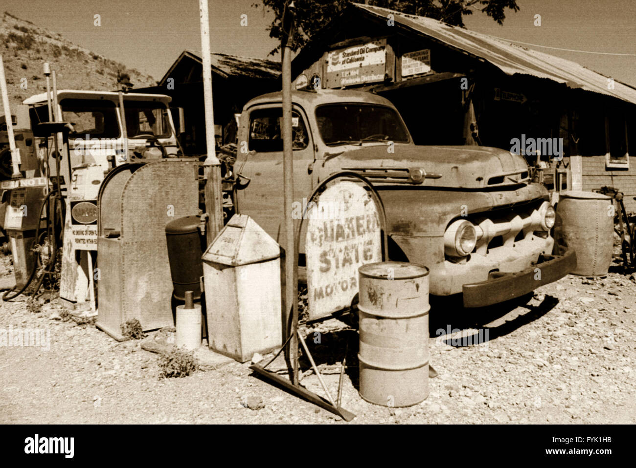 Early 1950s Ford F100 Pickup Truck Leading The Line At Gas Pumps An Old South West Usa Mining Towns General Store