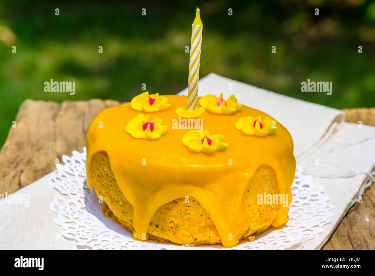 Yellow Motif One Year Old Birthday Cake - Stock Image