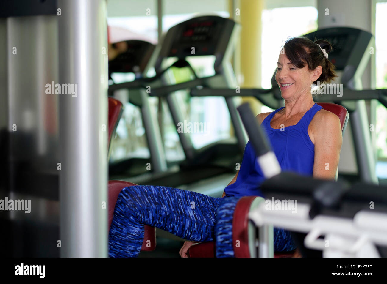 Workout exercise of a senior citizen woman at the gym - Stock Image