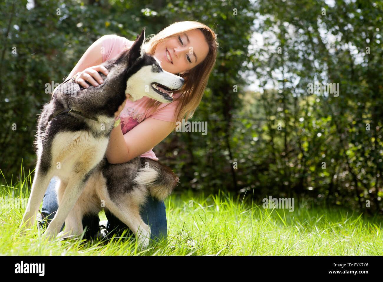 Girl and her husky - Stock Image