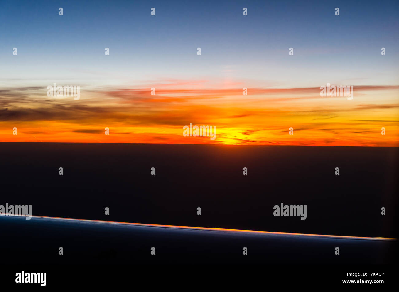 Sunset view from airplane - Stock Image