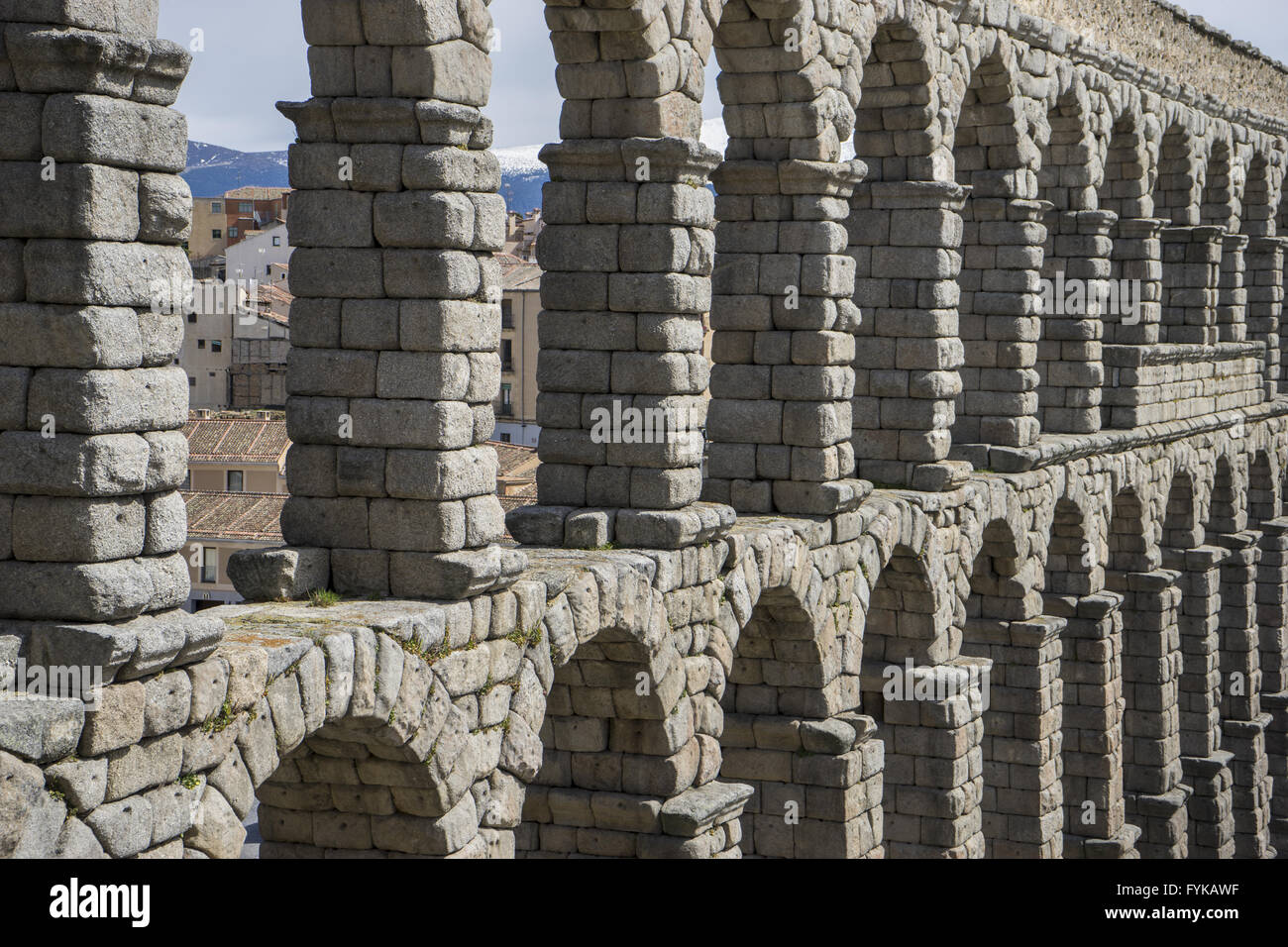 Tourist, Roman aqueduct of segovia. architectural monument declared patrimony of humanity and international interest - Stock Image