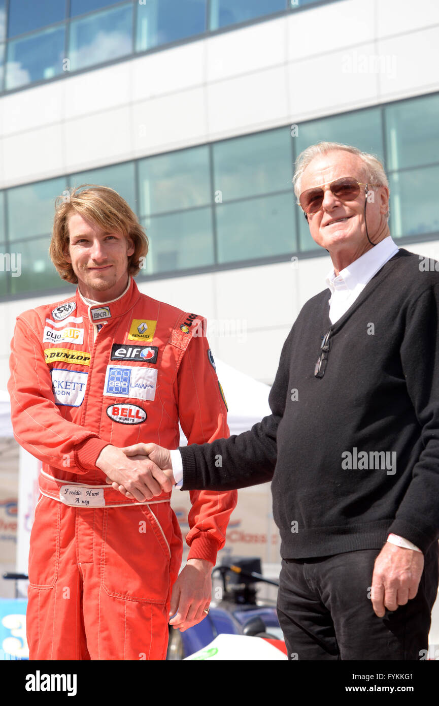 Freddie hunt, son of F1 champion James Hunt shakes hands with Alastair Caldwell  James's manager at MacLaren - Stock Image