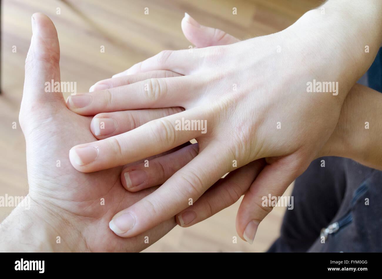 Friendly Handshake. Man And Woman Shaking Hands. - Stock Image