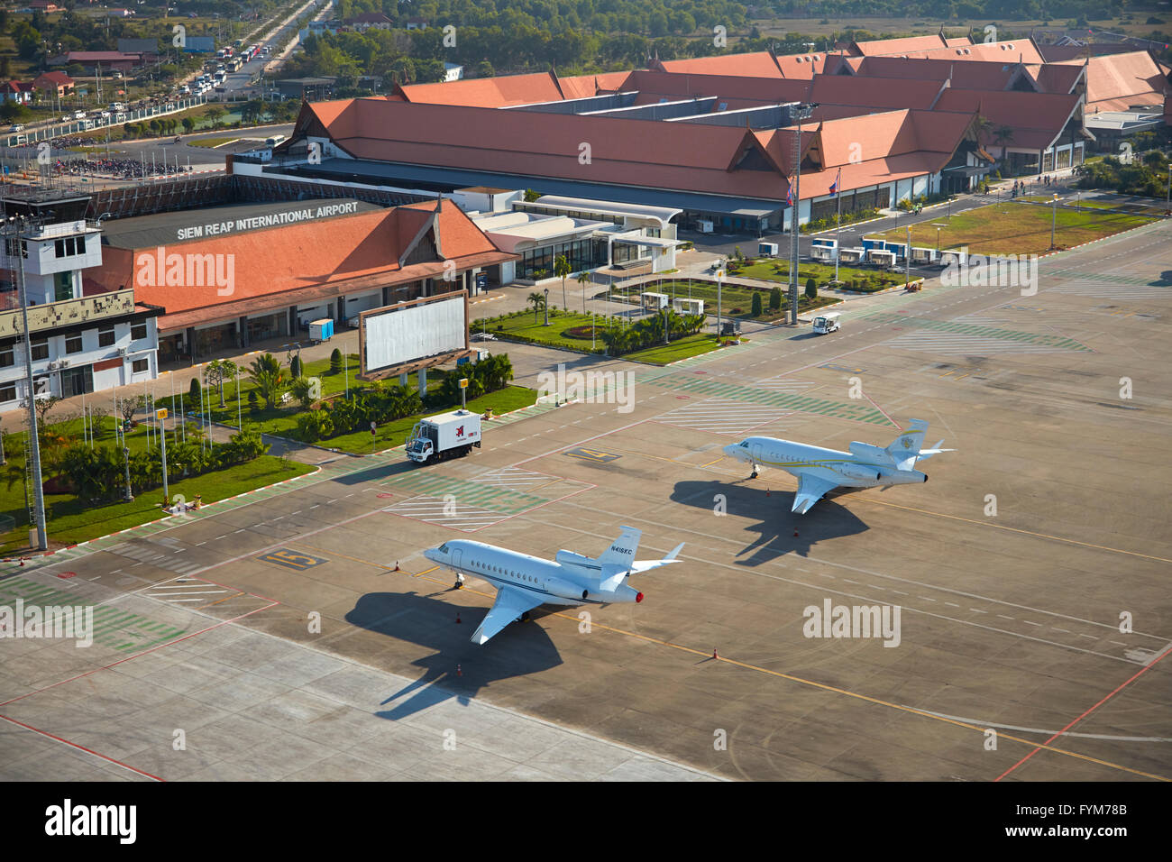 Private jets at Siem Reap International Airport, Siem Reap, Cambodia - aerial Stock Photo