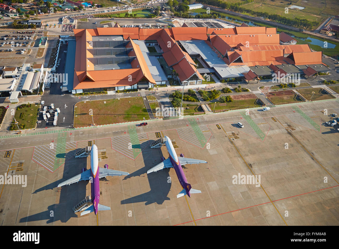 Cambodia Angkor Air planes at Siem Reap International Airport, Siem Reap, Cambodia - aerial - Stock Image