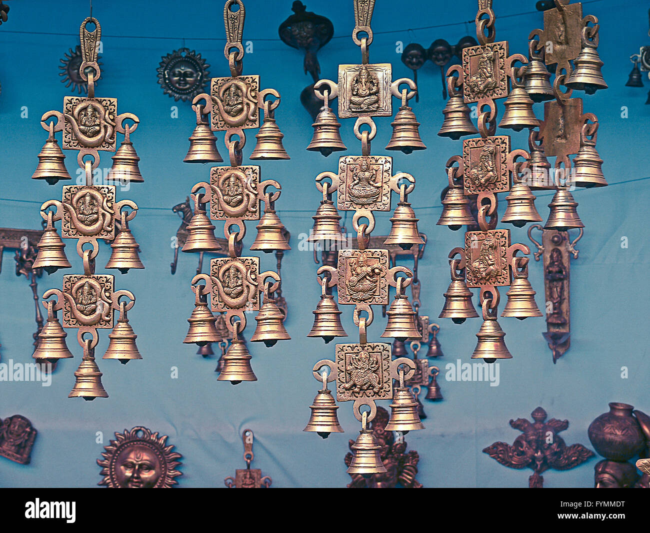 Brass made hanging showpieces with bells - Stock Image