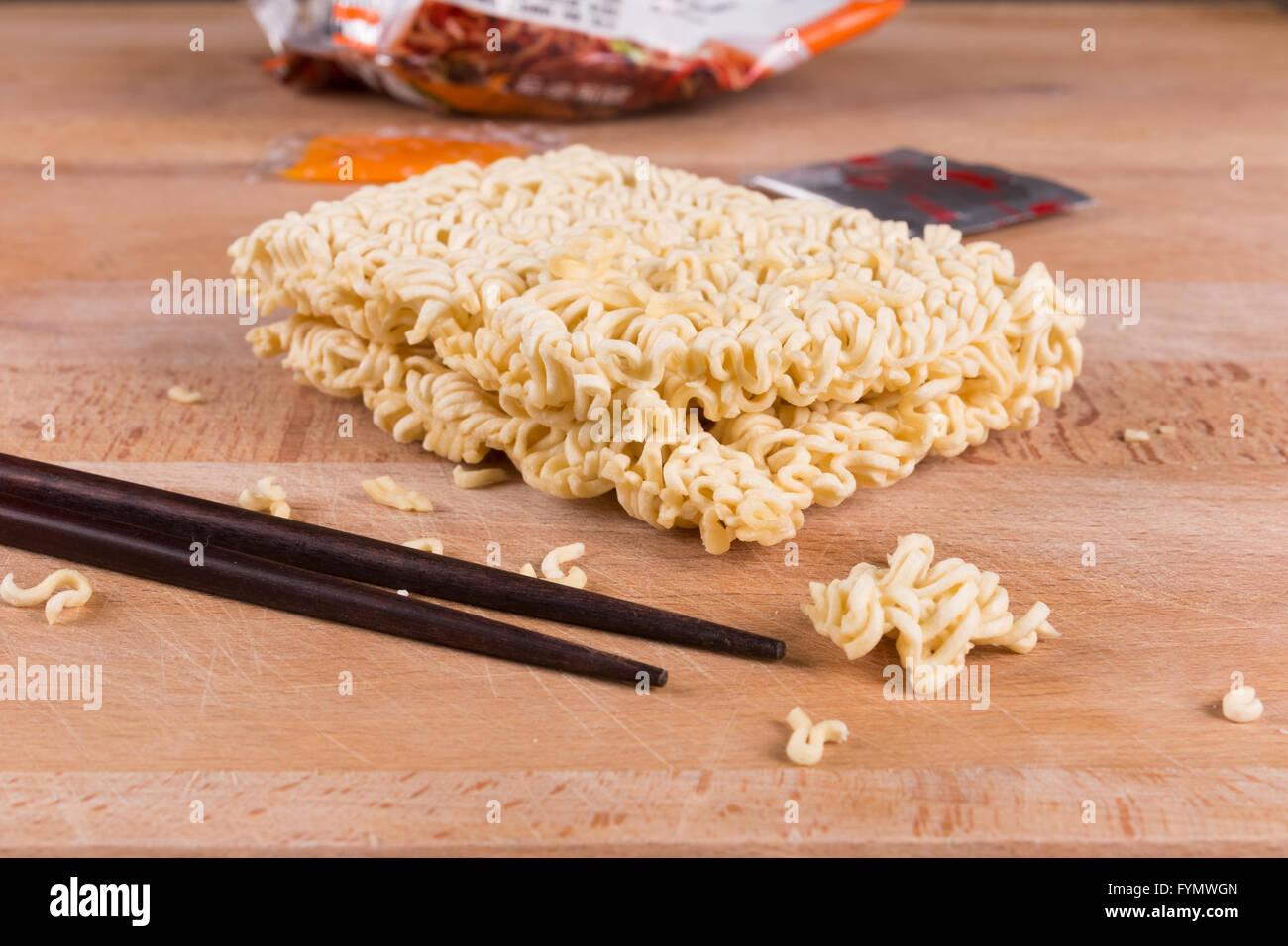 Block of uncooked ramen instant noodles - Stock Image