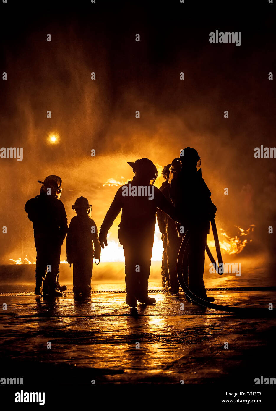 A child watching fire being put out - Stock Image