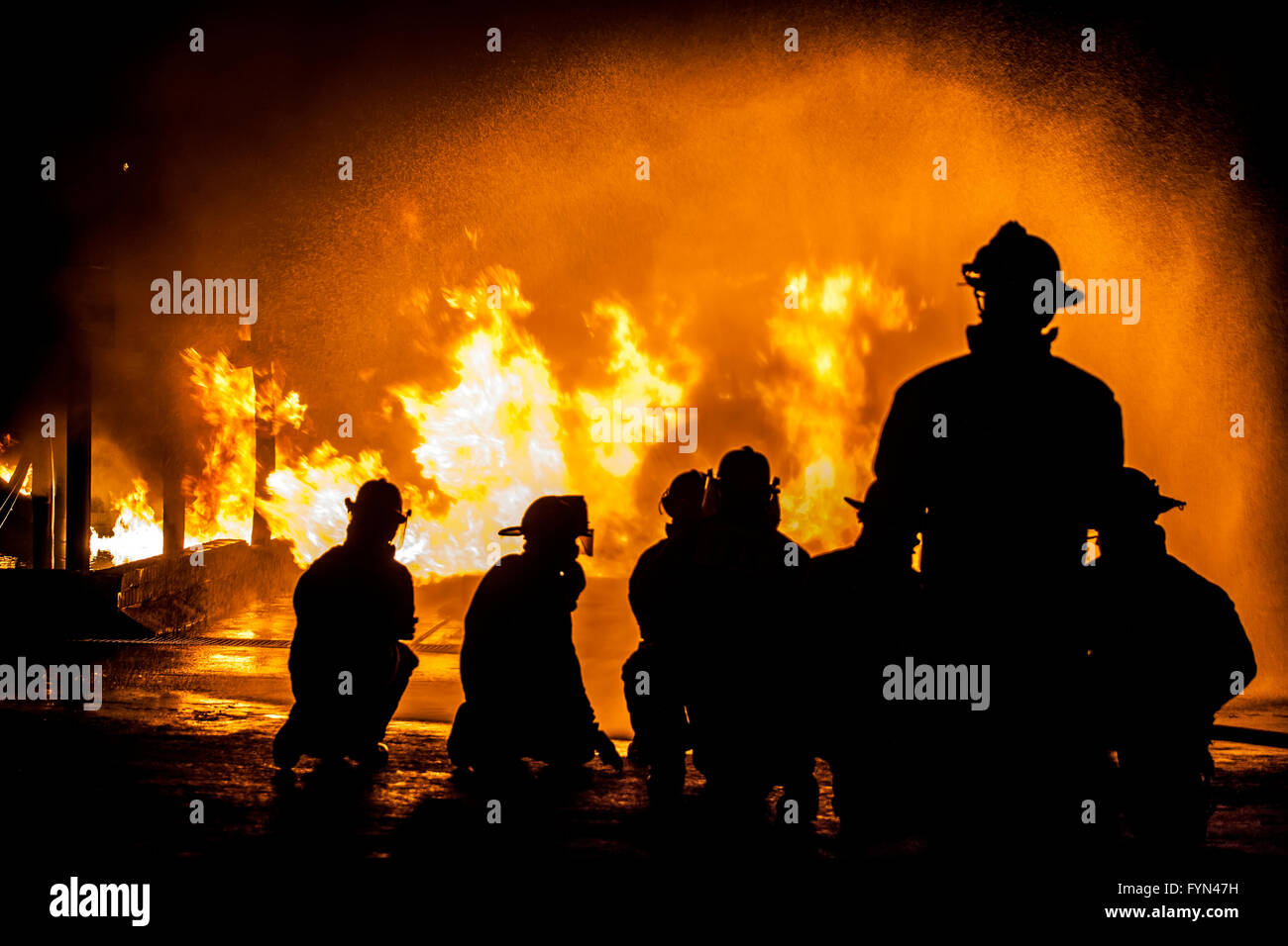 Firefighters assessing structural fire - Stock Image
