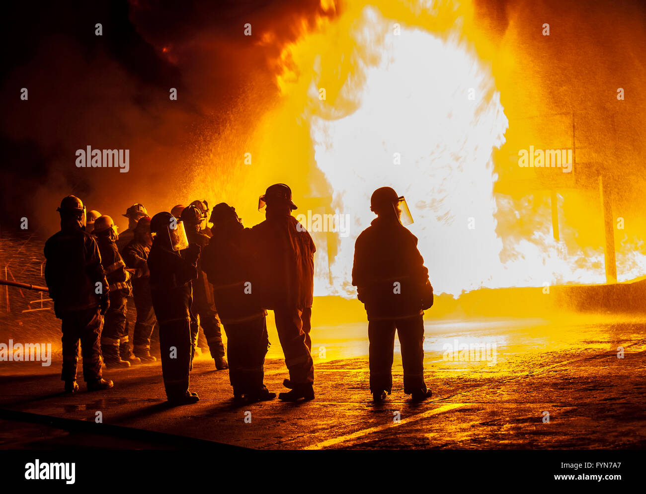 Firefighters observing structural fire - Stock Image