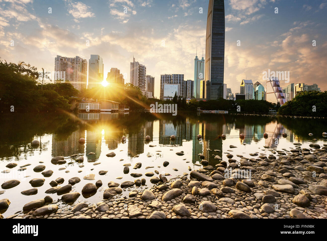 a brook besides skyscrapers - Stock Image