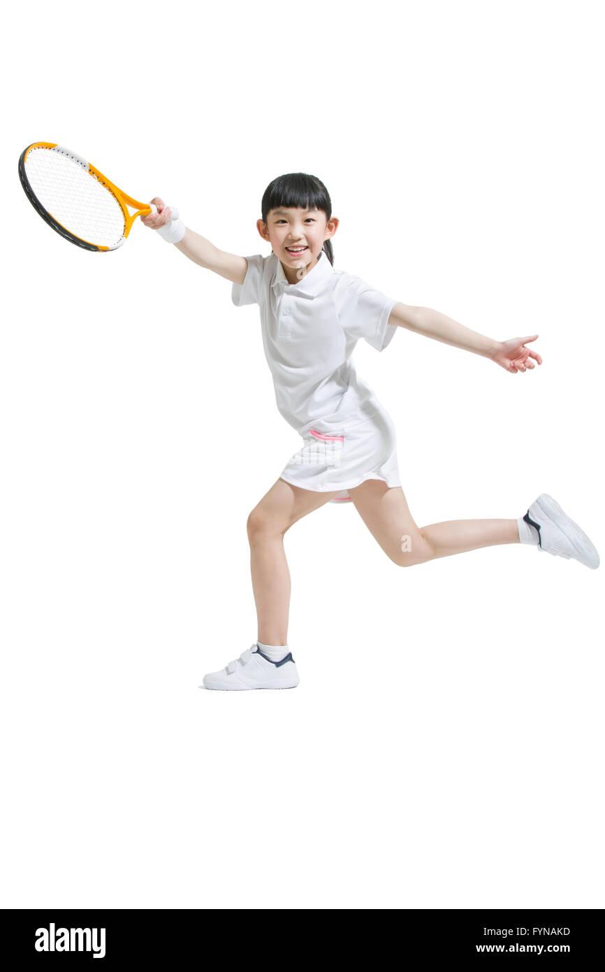 Cute girl playing tennis - Stock Image