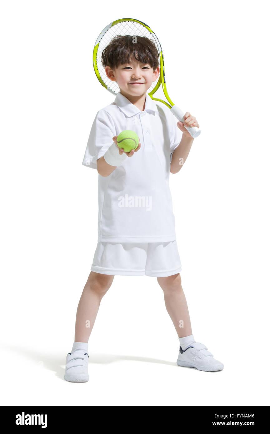 Cute boy playing tennis - Stock Image