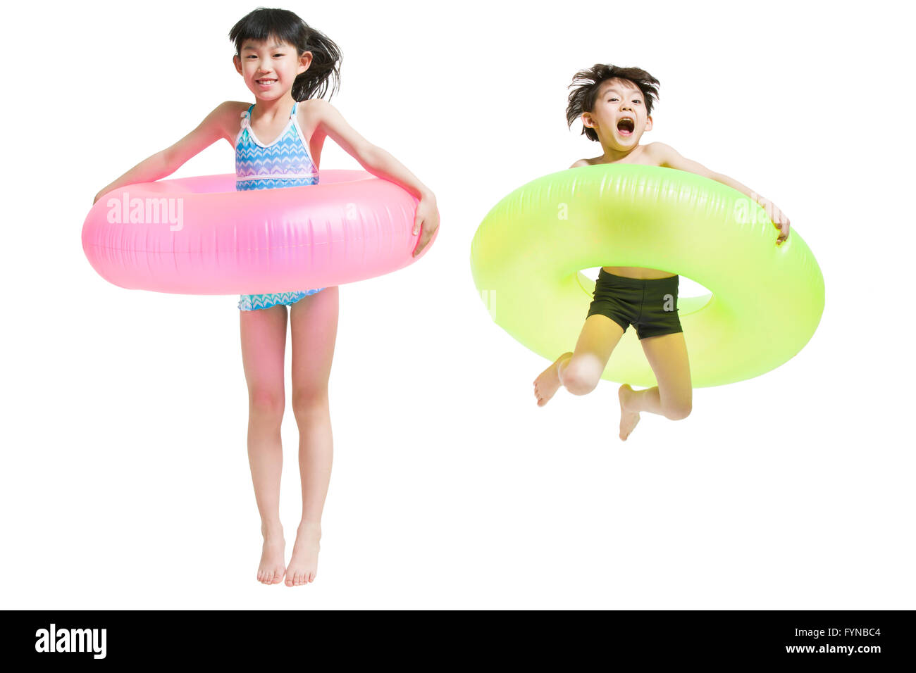Cute children in swimsuit with swim rings Stock Photo