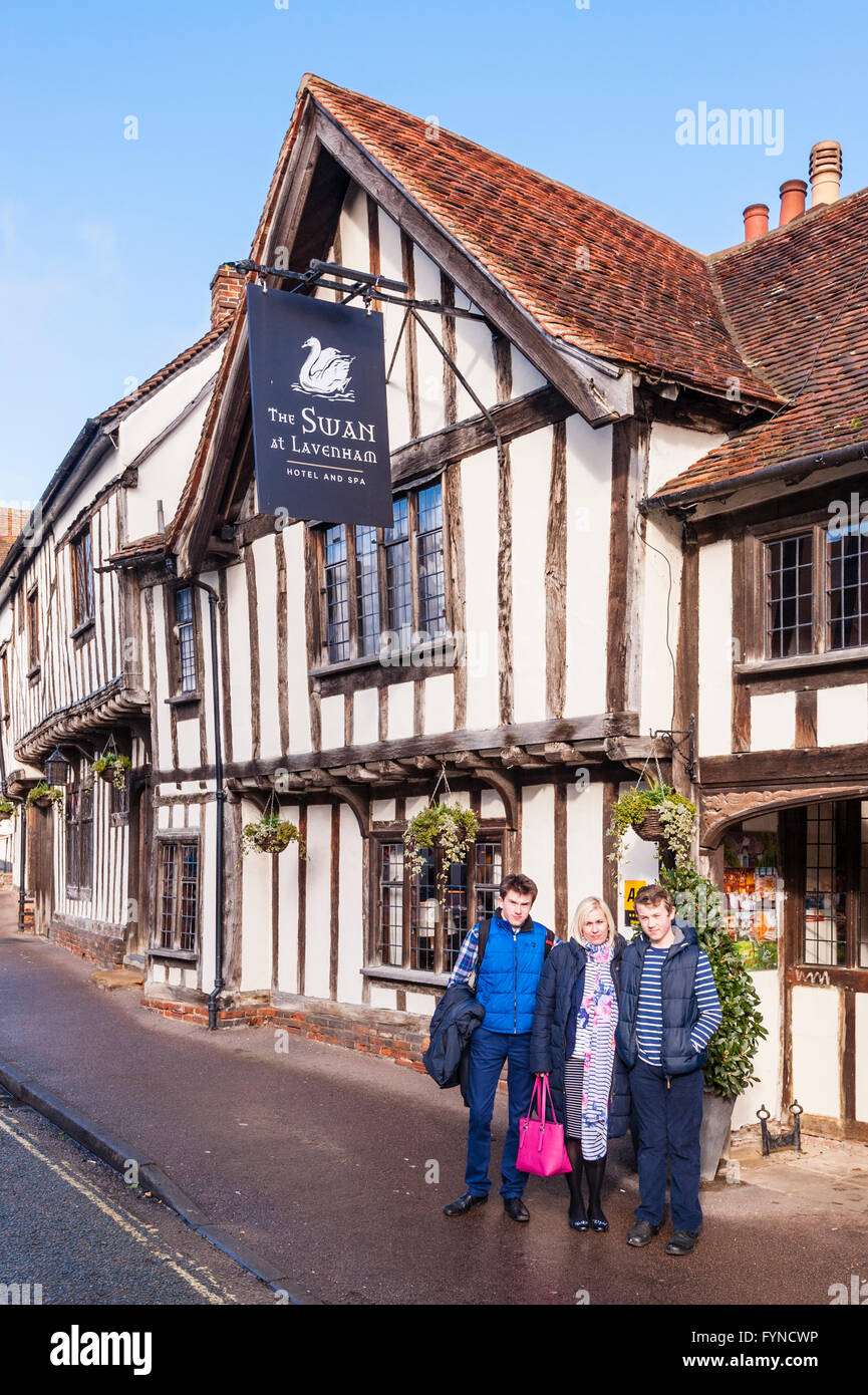 A family have their photo taken outside the famous Swan Hotel in the picturesque village of Lavenham , Suffolk , - Stock Image