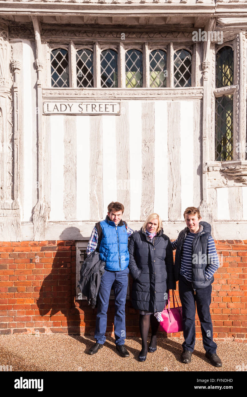 A family photo in front of the Guildhall  in the picturesque village of Lavenham , Suffolk , England , Britain , - Stock Image