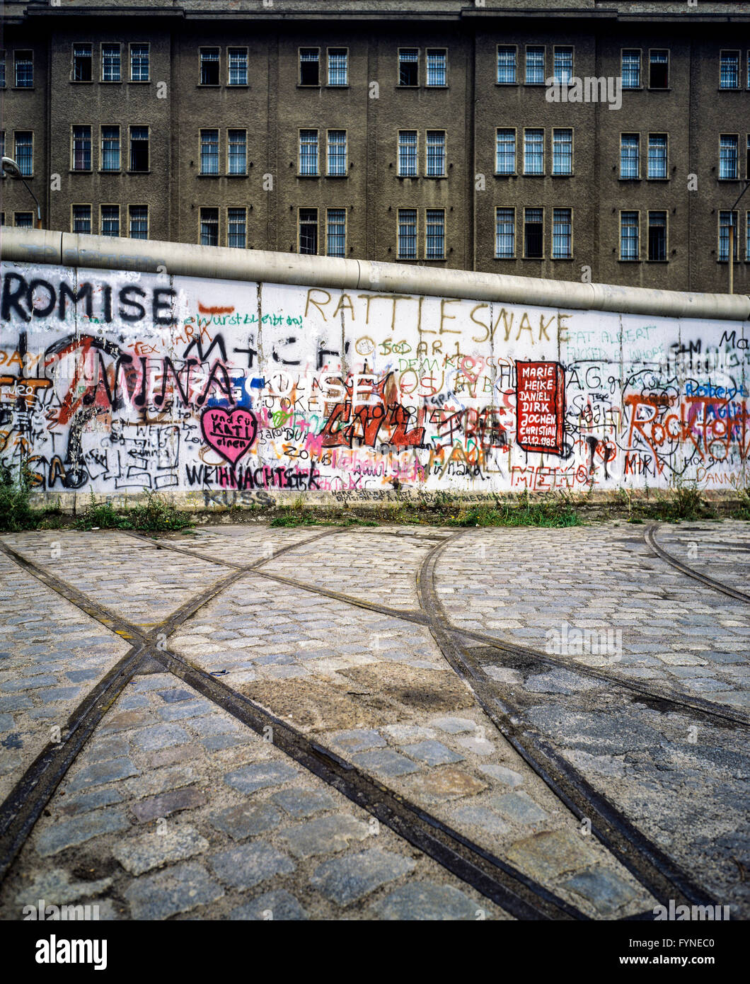 August 1986, Berlin Wall graffitis, tram track ending into wall, East Berlin building, West Berlin side, Germany, - Stock Image