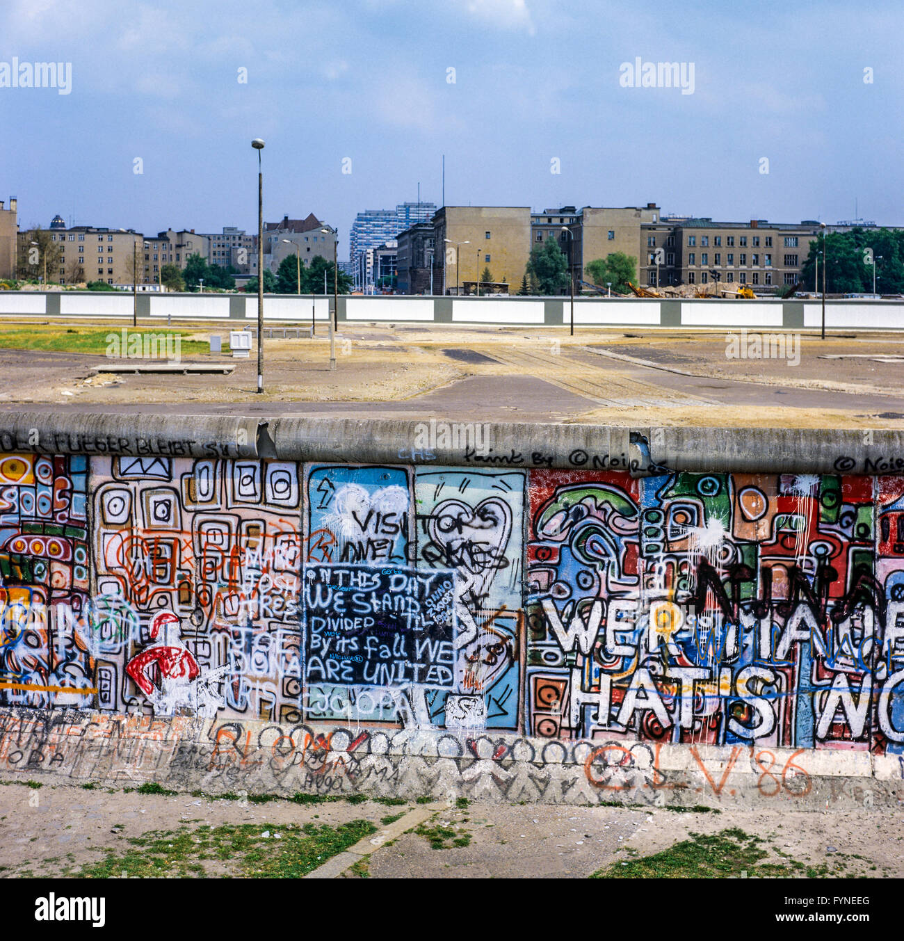 August 1986, Berlin wall graffitis at Potsdamer Platz square with view over Leipziger Platz square, death strip, - Stock Image