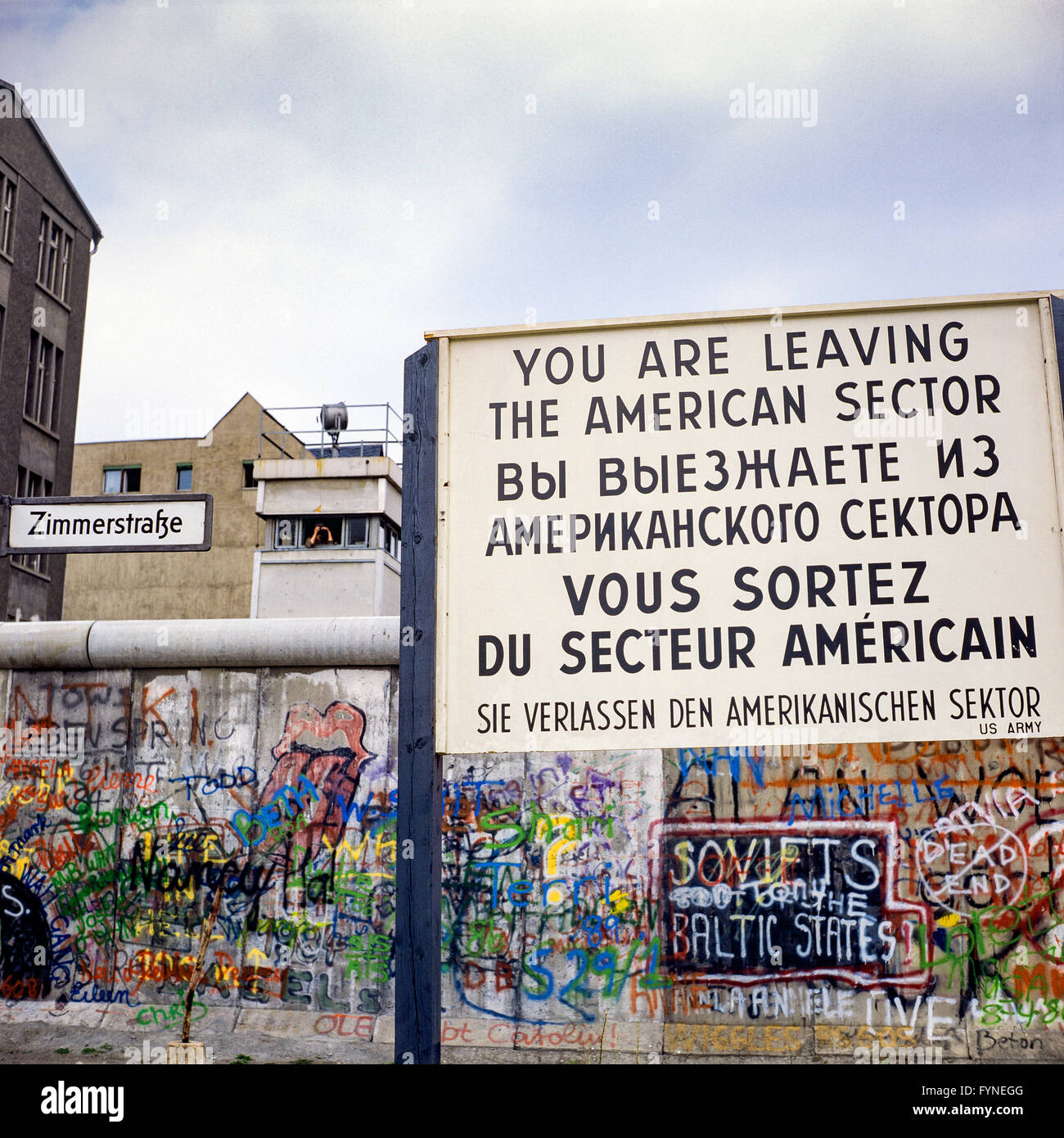 August 1986, leaving American sector warning sign, Berlin Wall graffitis, East Berlin watchtower, Zimmerstrasse Stock Photo