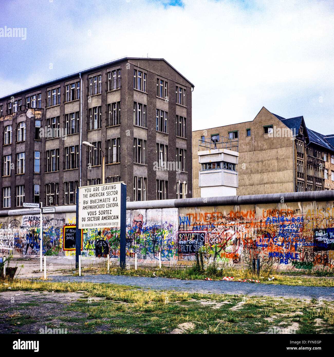 August 1986, leaving American sector warning sign, Berlin Wall graffitis, East Berlin watchtower, Zimmerstrasse - Stock Image
