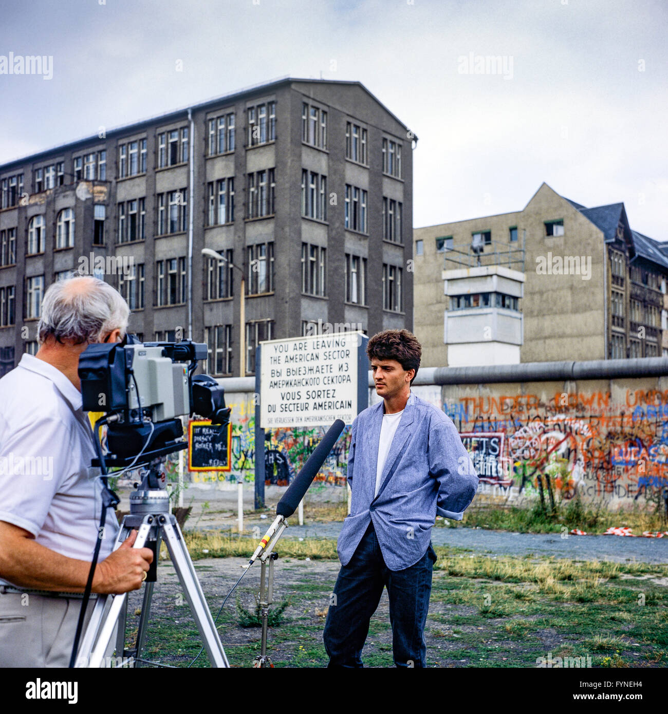August 1986, TV interview of a former East soldier, Berlin Wall graffitis, East Berlin watchtower, Zimmerstrasse - Stock Image