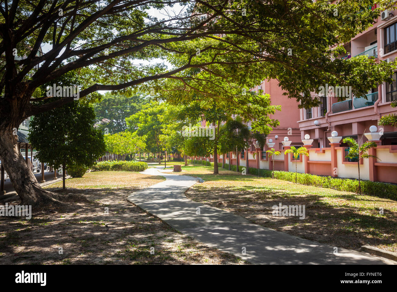 Pleasant urban pathway in the city of Kota Kinabalu, Borneo Malaysia - Stock Image